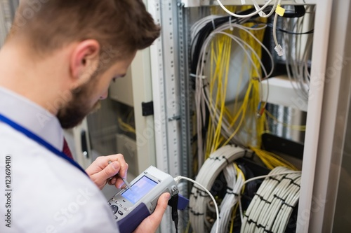 Technician using digital cable analyzer Canvas Print