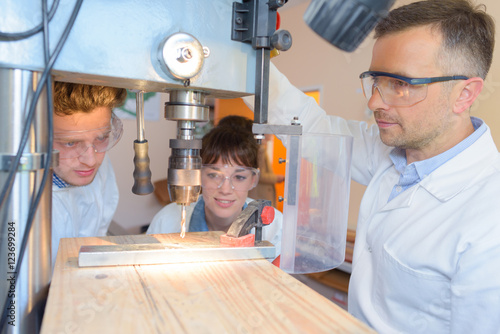 Students watching instructor use bench drill Canvas Print