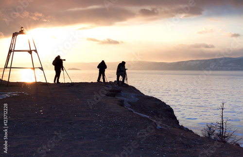 Photographers Are Taking Photos At Sunset Time People Silhouette Winter Lake Baikal