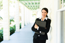 Attractive Female Woman Real Estate Agent Businesswoman On House Veranda