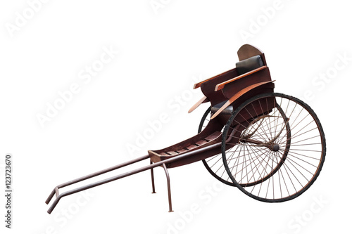 Fotografia, Obraz  Old vintage chinese hand pulled rickshaw  isolated on white background