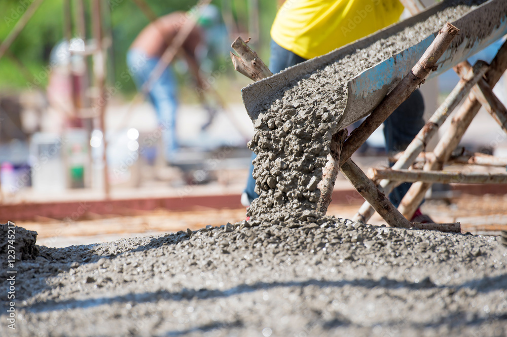 Fototapeta Selective focus of concrete pouring during commercial concreting floors of building