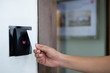 Door access control with a hand inserting key card to lock and u