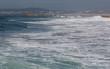 Ocean waves in Costa da Caparica. Autumn day in Almada, Portugal.
