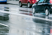 Cars Driving On Wet Asphalt Ro...