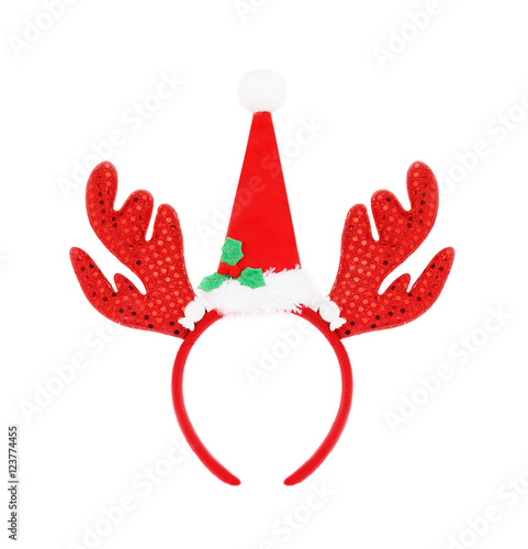 54d9893ad430f Pair of headband reindeer horns and santa hat isolated on white ...