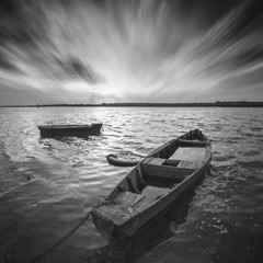 FototapetaBoats on a river. Monochrome picture