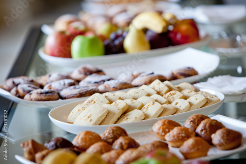 Obraz na plátně  table covered with cakes and fruits