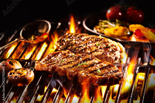 Aluminium Prints Grill / Barbecue Grilled rump steak with mushrooms over flames