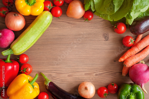 Fototapeta Frame of fresh colorful vegetables on wooden table, top view. Harvest, culinary, autumn background. Copy space. obraz na płótnie