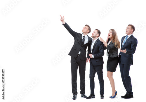 Fotografía  Just look at this! Full length of group of surprised and amazed business people looking and pointing away