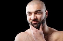 Power And Confidence. Close Up Portrait Of Strong Latino Man With Beard Against Black Background.