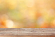 Blank wooden table on blurred golden background.