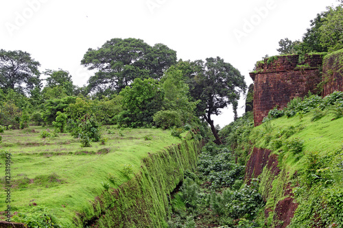 Papiers peints Fortification Remains of the deep trench made around for security in Cabo de Rama Fort in Goa, India. A centuries old fort, last owned by the Portuguese during their occupation of Goa.