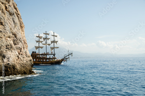 Foto op Canvas Schip pirate ship on the sea with people