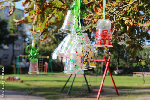 Recycle project of plastic bottles and cups, colored with
