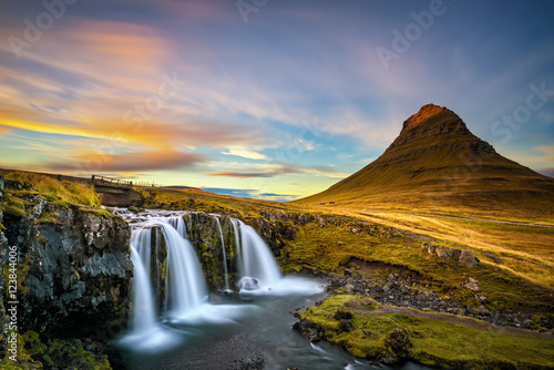 Sunset over Kirkjufellsfoss Waterfall and Kirkjufell mountain in Iceland