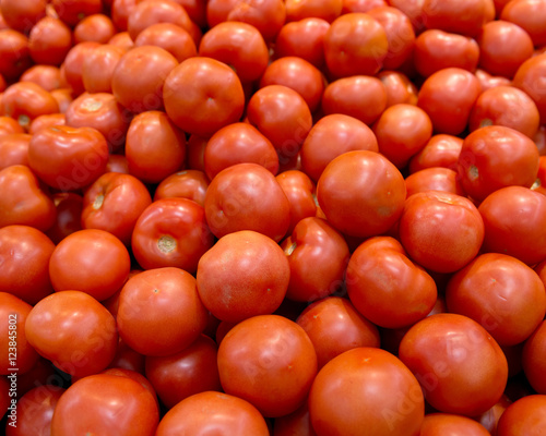 Ripe organic tomato on shelf in local farmers store