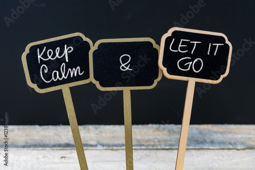 Photo  Keep Calm and Let It Go message written with chalk on mini blackboard labels