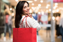 Smiling Woman Shopping For Dresses