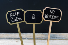Keep Calm And No Worries Message Written With Chalk On Mini Blackboard Labels