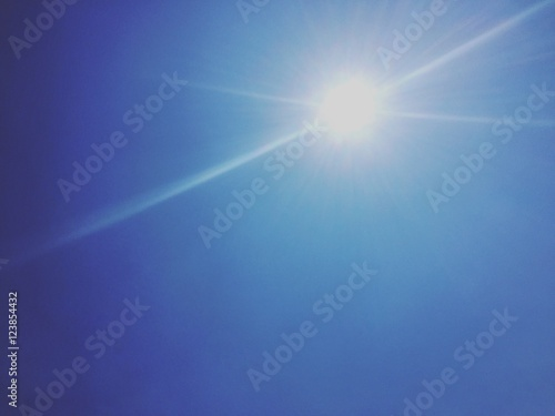 Fototapeta Blue skies and sun beams obraz na płótnie