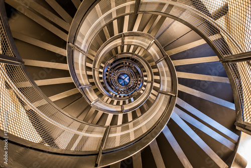Foto op Plexiglas Trappen Spiral staircase in tower - interior architecture of building
