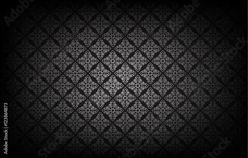 Foto  Thai art pattern on black background.vector illustration