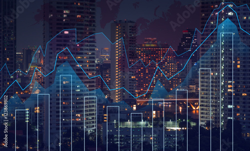 Trading graph on the cityscape at night and world map background Canvas-taulu