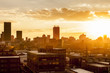 canvas print picture - City during warm sunset