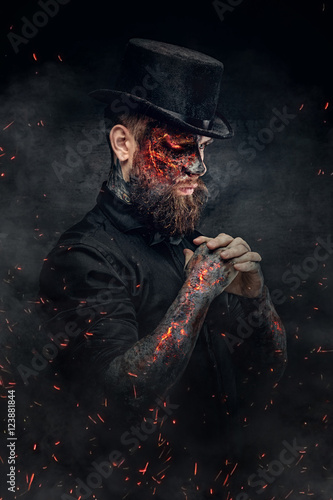 A man with burning face and arm. Fototapeta