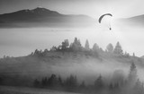Flying above foggy valley. Monochrome colors - 123885284