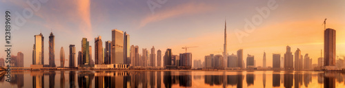 Fotografie, Tablou Panoramic view of Business bay and downtown area of Dubai, reflection in a river