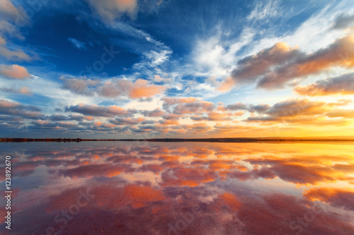 Keuken foto achterwand Beige Beautiful sunset landscape. Cloudy sky above salt lake.