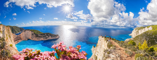 Poster Tropical plage Navagio beach with shipwreck and flowers on Zakynthos island in Greece