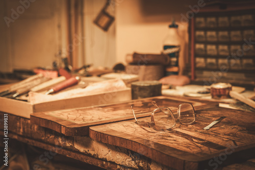 Photo  Close-up of the restorer worktable in his workshop