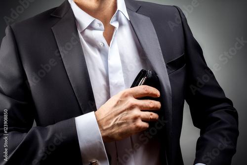 Fotografía  Man pulled out of his inside jacket pocket wallet