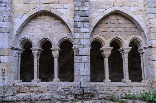 sight of the columns, arches and capitals of the courtyard of the cloister of the Romanesque abbey of Santa Maria the Real one in aguilar of Campoo, Palencia, Spain
