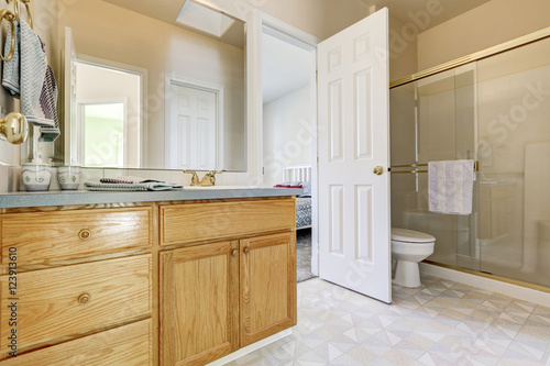 Foto op Canvas Trappen Wooden vanity cabinet, glass shower and a toilet
