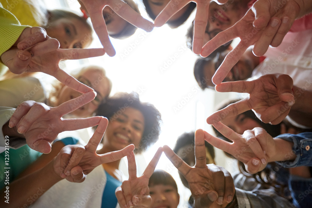 Fototapety, obrazy: international students showing peace or v sign