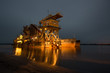 canvas print picture - dredger at night during the operation