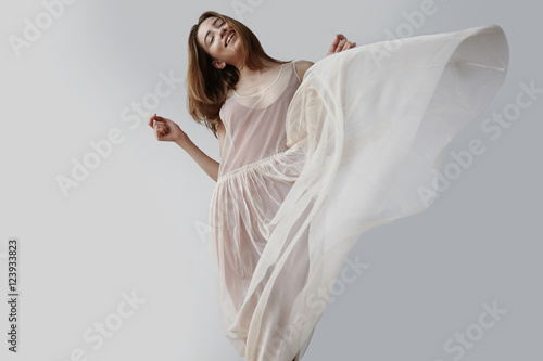 Photo  blonde woman wears transparent dress of balerina. blowed dress b