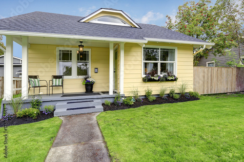 Photo  Small American yellow house exterior