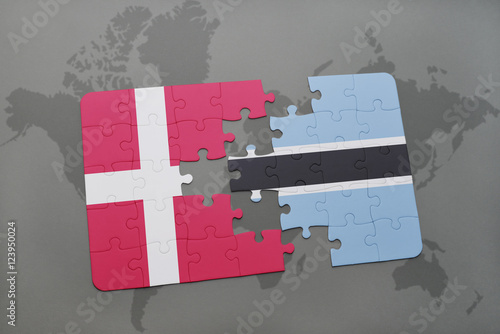 Photo  puzzle with the national flag of denmark and botswana on a world map background