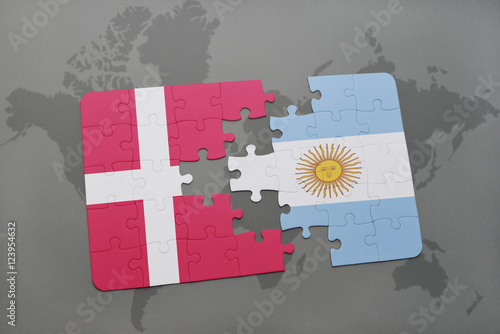 Photo  puzzle with the national flag of denmark and argentina on a world map background