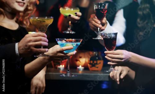 People drinking colorful cocktails at Halloween party, closeup Poster Mural XXL
