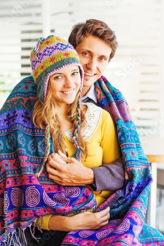 Papiers peints Attraction parc loving caucasian couple wearing woolen clothes (focus on girl's