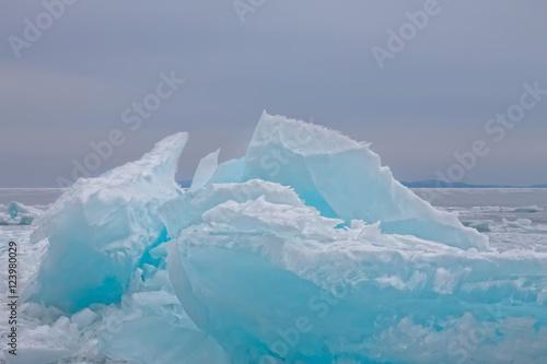 Poster Antarctic Clumps of blue ice hummocks lake at dusk