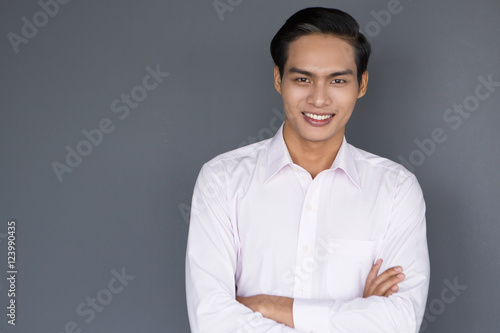 Fototapety, obrazy: Smiling Young Asian Businessman with Crossed Arms