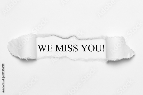 Foto We miss you! on white torn paper
